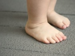 baby feet on deck